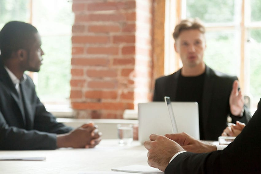 embracing conflict in a team meeting